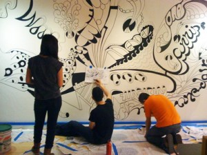 Painting the Design Journeys Mural at th...